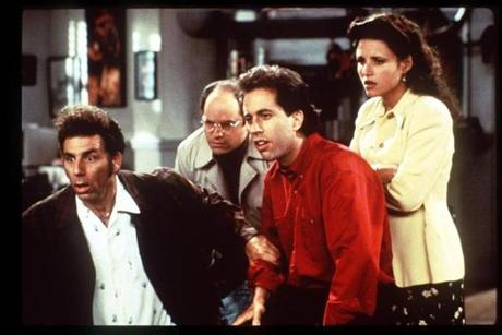 "Julia Louis-Dreyfus with Michael Richards, Jason Alexander, and Jerry Seinfeld on ""Seinfeld."""